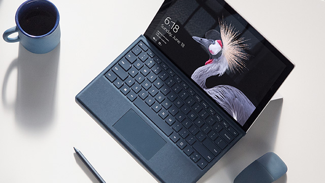 Image of Surface Pro device on a table with Surface Pen and Surface Arc Mouse.