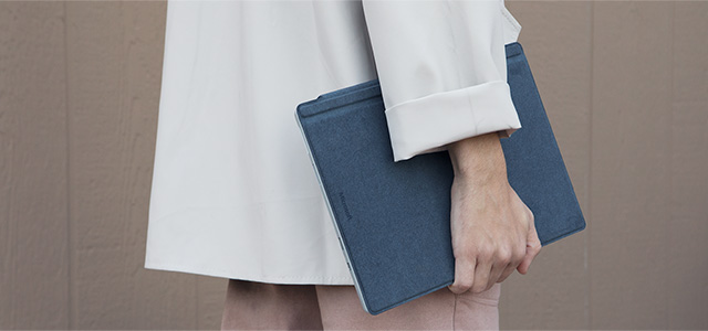 Image of a person carrying Surface Pro device.